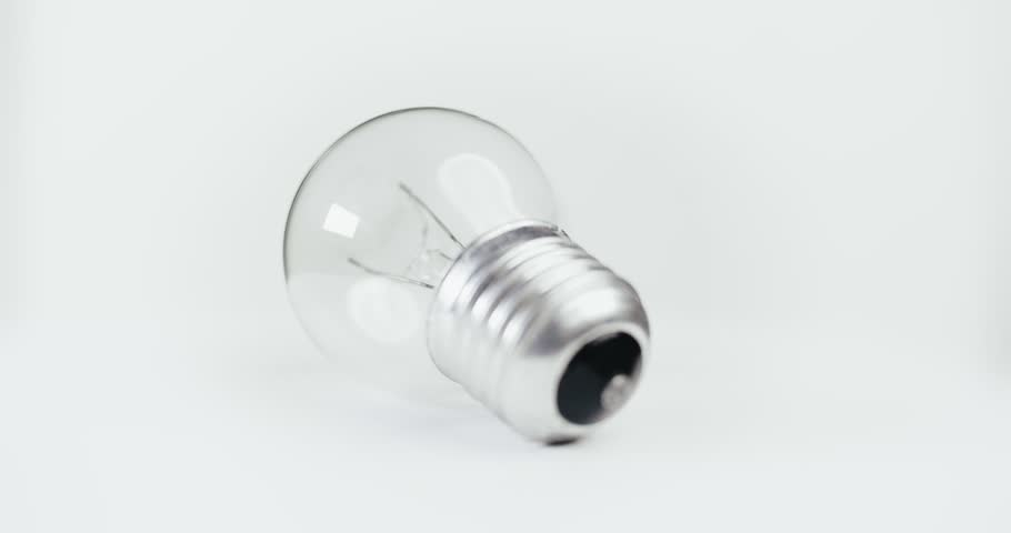 Light bulb on white background isolated. Picture of electric bulb moving round seamles loop | Shutterstock HD Video #1015424788