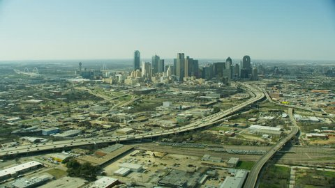 Aerial view of city vehicle freeway residential suburbs downtown urban skyscrapers Dallas Texas America RED WEAPON
