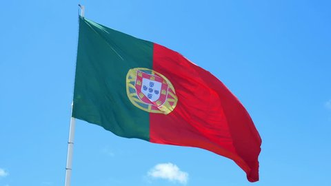 Isolate flag of Portugal on a flagpole fluttering
