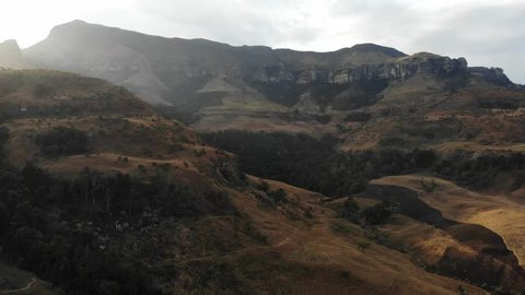 The sun dipping below the high mountains of the Northern Drakensberg, South Africa