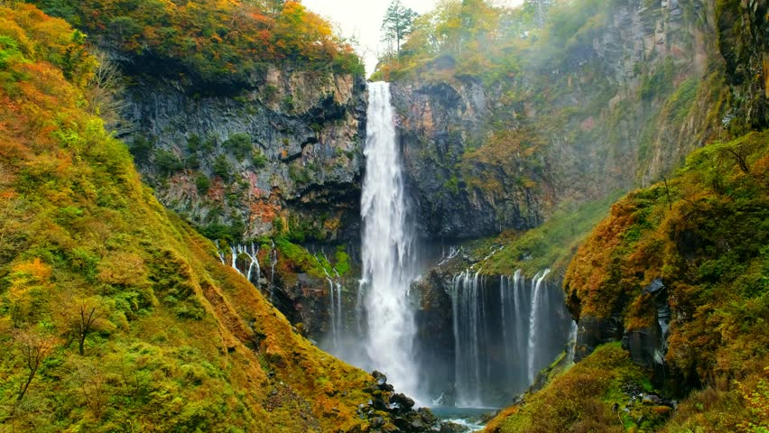 Kegon Waterfall in autumn trees colorful waterfall from lake Chuzenji in Nikko national park, Beautiful in autumn leaves (koyo) season at Tochigi ,Japan | Shutterstock HD Video #1015504588