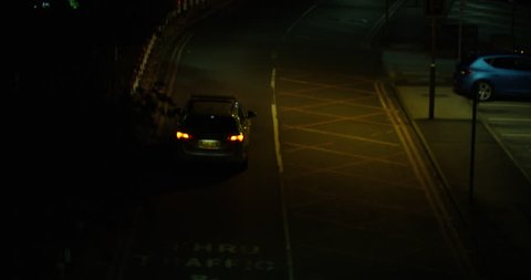 A British Police Car Leaving For An Emergency Late at Night. Driving to an Incident. Dark Dim Road. A 999 Call in Britain.