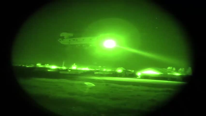North Carolina, The United States - August 12, 2018: Night vision of multi mission aircraft flying over military base