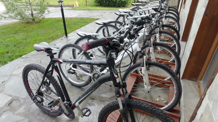 BANSKO, BULGARIA - 12 DEC, 2016: Row of bikes for rent on bicycle parking, bike is popular mountain transportation for tourists in Pirin National Park