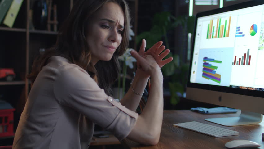 Upset business woman working with economic data on computer at night. Dissatisfied business woman looking marketing indicators in report. Business crisis concept. Stress at work   Shutterstock HD Video #1015580578