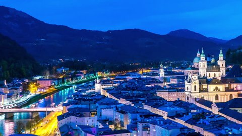 Spectacular panorama time-lapse view on the historic architecture of the city centre during sunset in Salzburg, Austria.
