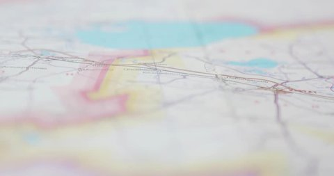 Closeup of male hands pointing on travel map places to visit. Tourist man planning summer vacation journey and poitining on travel map with finger travel destination. 4k