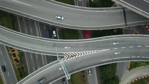 Aerial drone accent large road intersection highway from high altitude, Center of KL Kuala lumpur capital Malaysia development. Modern city traffic car move.