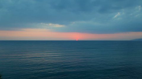 The sun goes beyond the horizon and dissolves into the sea