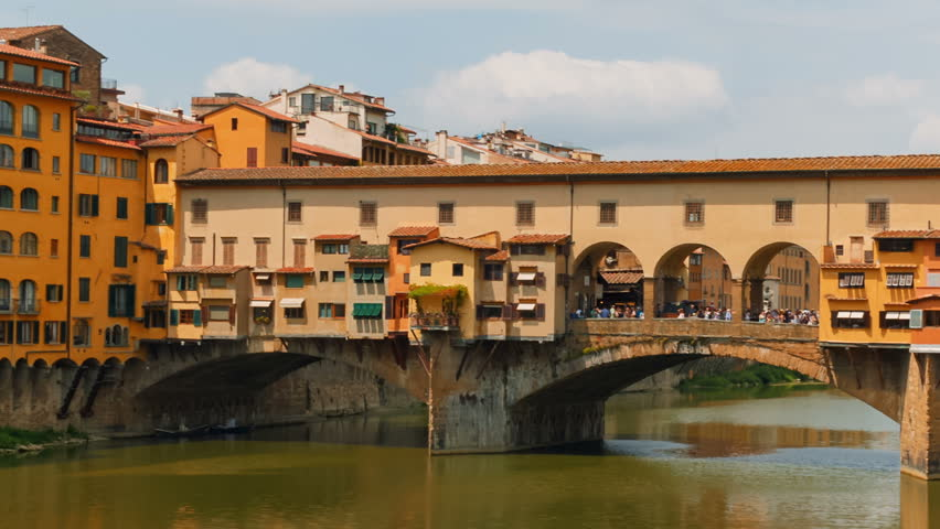 Telephoto shot of the Ponte Vecchio and the Arno River, in Florence, Tuscany, Italy, known for its traditional shops. Florence is considered the birthplace of the Renaissance