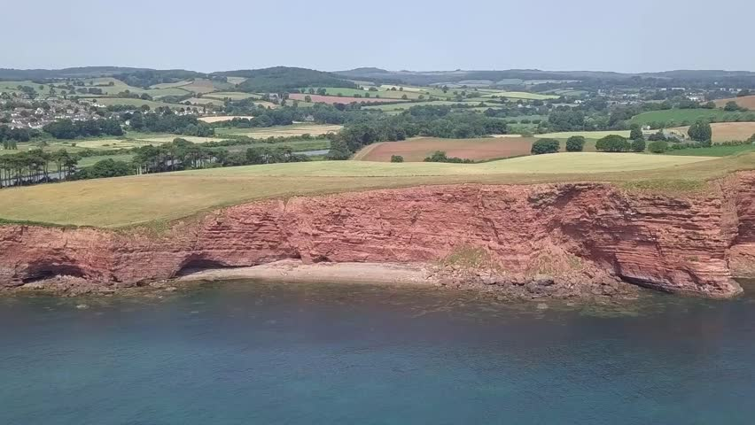 STATIC CROP aerial,ing toward red cliffs along the Jurassic Coast world heritage site
