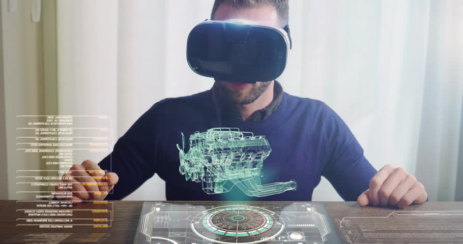 An engineer designs an electric engine using sophisticated and futuristic programs with holography. Concept of: cars, future, project and augmented reality.