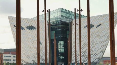 Belfast, Northern Ireland - August, 29, 2018: Titanic Belfast building. Viewed from the Slipways. Zooms out showing people walking on a slipway