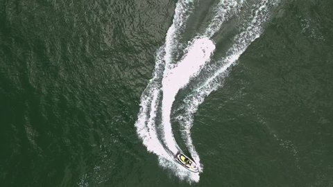 Jet-ski riding on the water from above
