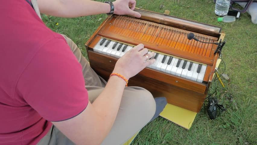 Close Shot Of Playing Harmonium A Musical Instrument. Traditional India Musical Instruments Harmonium