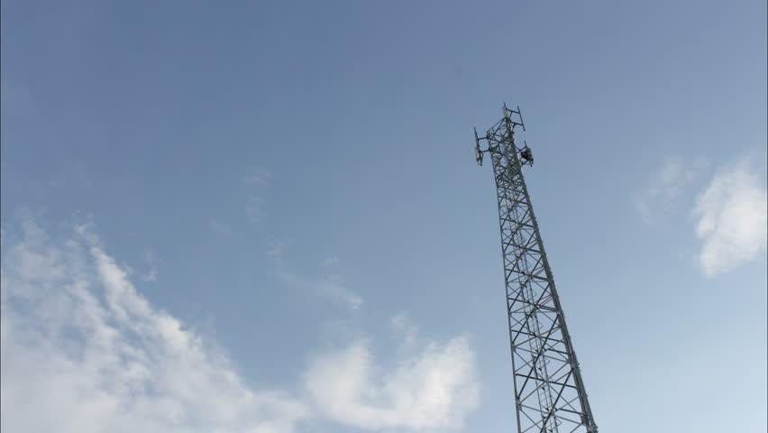Telephone pole and blue sky time lapse