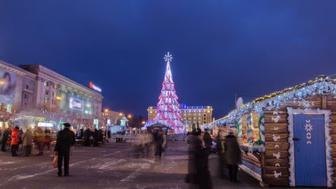 The Central city Christmas tree at the liberty square timelapse hyperlapse in Kharkov, Ukraine. Opening the Christmas tree in the evening city. New year.