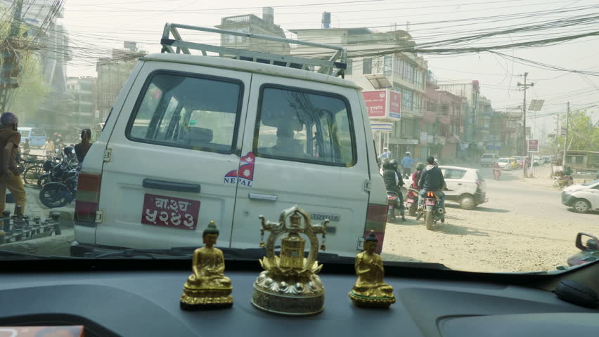 KATHMANDU, NEPAL - MARCH, 2018: View from the car on heavy traffic on the streets of the tourist area Thamel in the center of the city.