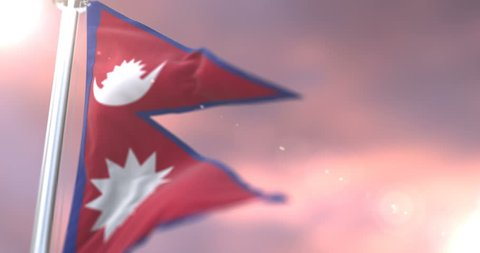 Flag of Nepal waving at wind in slow at sunset, loop