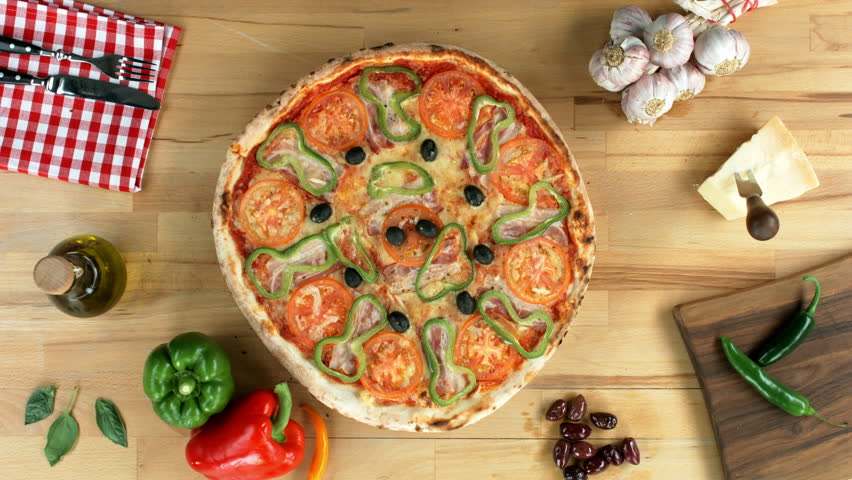 Delicious pizza with added olive oil. Top view, female hands.  | Shutterstock HD Video #10159118