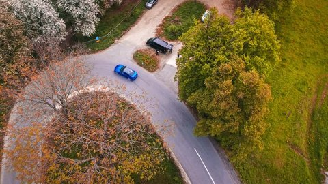 Aerial drone tracking shot of a BMW M6 cars drifting on a mountain road in Austria