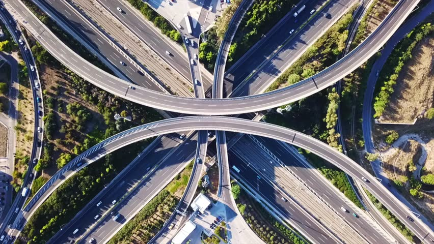 Aerial drone timelapse video of urban elevated toll road junction and interchange overpass in National road and Attiki odos of Attica, Athens, Greece