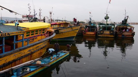 Visakhapatnam, Andhra Pradesh, India - August 05, 2018: View of fishing vessels tied up at the fishing harbor in Visakhapatnam, Andhra Pradesh, India.