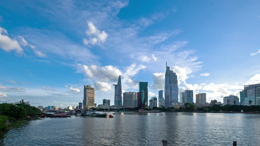 Timelapse landscape sunny day clear sky of Ho Chi Minh city or Sai Gon. Royalty high quality free stock footage time lapse of Ho Chi Minh City in clouds sky.  Timelapse or time lapse is fast video