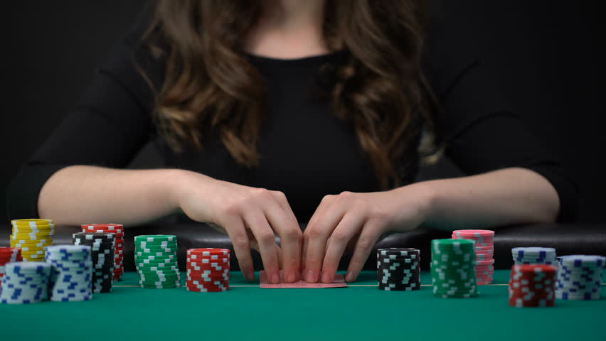 Woman checking cards and betting casino chips, risky poker tournament, gambling | Shutterstock HD Video #1016162098