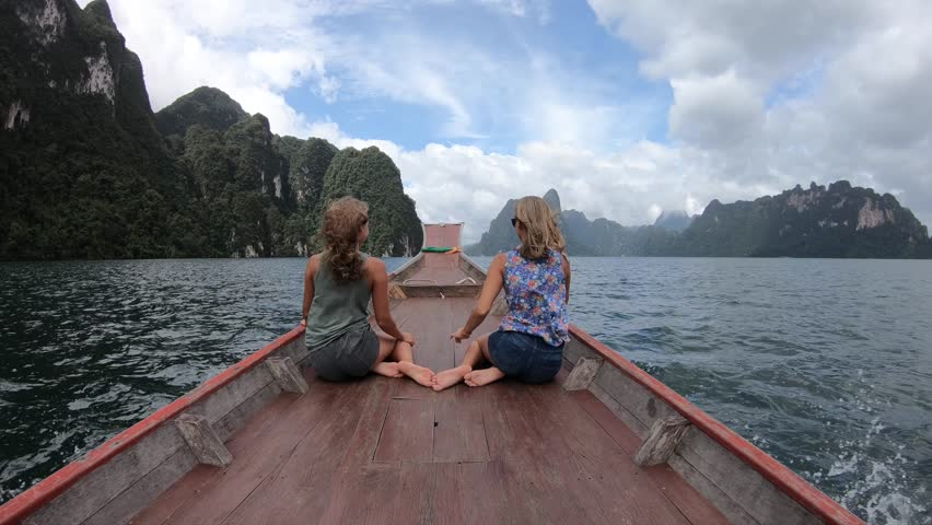 Two happy woman traveling by boat and enjoying the sun. Koh Hong, Thailand | Shutterstock HD Video #1016171158