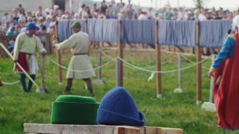 People walk around in historical costumes in the center of the event tournament. Festival of the middle ages