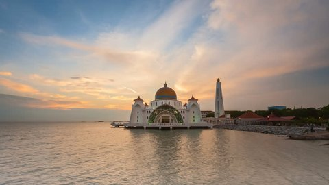 Dramatic Time lapse of sunset and scattered clouds at Masjid Selat in Melaka, Malaysia. Day to night. Prores Full HD 1080p.