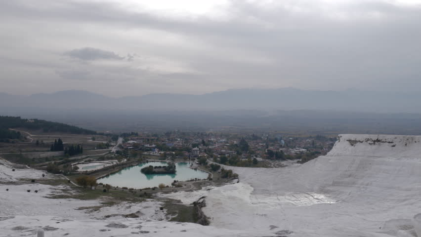 Observing the panorama of town and distant mountains from travertine terraces in Pamukkale, Turkey