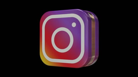 Kiev, Ukraine - September 03, 2018: A 3D rendering of a spinning instagram icon on black background and green screen. Seamless loop.
