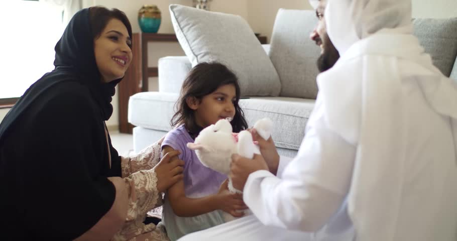 Happy family in Dubai playing together at home. Lifestyle moments inside the house