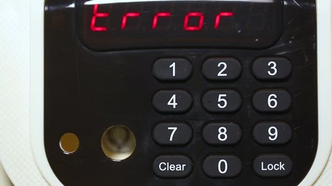 Woman uses modern electronic safe entering combintaion of four numbers to lock and unlock door. Wrong code and word Error written on display. Real time full hd video footage.