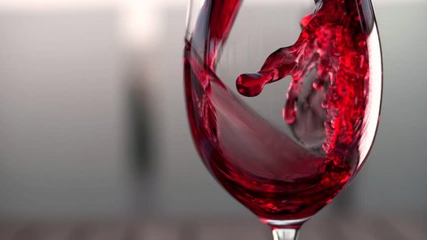 Red wine forms a beautiful wave in a glass fuse