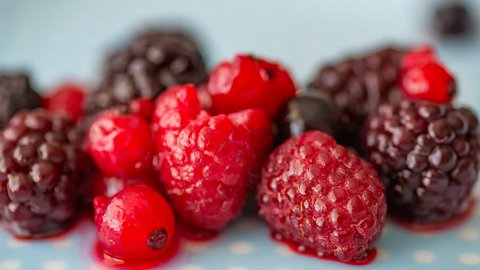 Timelapse footage of freezing fruits on the plate. Freezing raspberry and blackberry