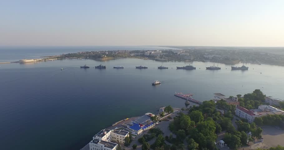 Shooting from the air of  Sevastopol bay, warships in the roads, Russian Navy Day 2015 | Shutterstock HD Video #1016330428