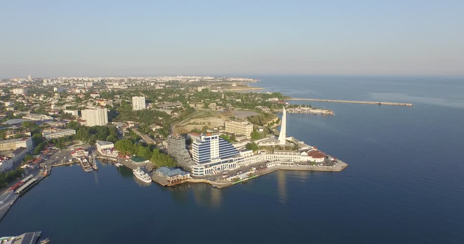 Shooting from the air of  Sevastopol bay, warships in the roads, Russian Navy Day 2015, soldier and sailor memorial, Cape Crystal, memorial obelisk | Shutterstock HD Video #1016331028