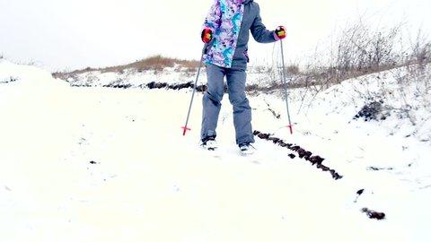 Little girl enjoying wintertime while skiing