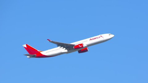 NEW YORK - 2018: Avianca Airbus A330-300 Commercial Jet Airplane Flying in a Clear Blue Sky after Taking Off from JFK International Airport