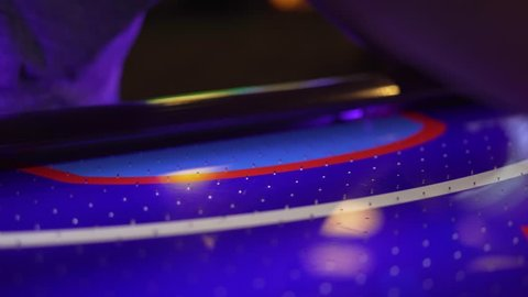 4K shot of a girl accidentally knocking an air hockey puck into her own goal.