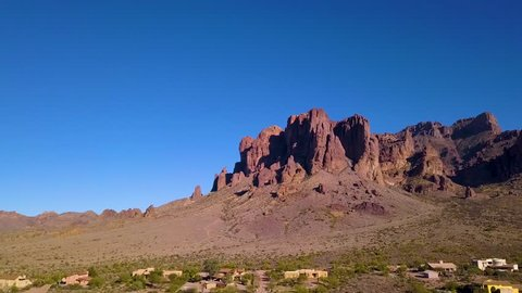 Aerial shot flying towards the north end of the Superstition Mountains in Apache Junction, Arizona.