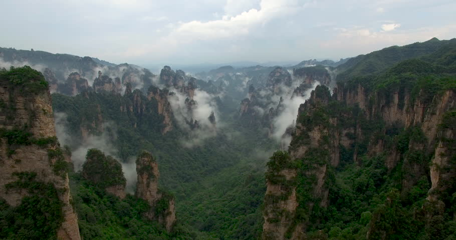 Amazing aerial view of the spectacular mountain landscape of Zhangjiajie, a national park in China known for its surreal scenery of rock formations.  | Shutterstock HD Video #1016503138