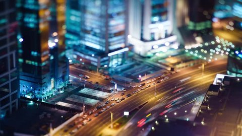 High angle view of traffic during the night in West Bay, Doha, Qatar. Miniature tilt-shift effect.