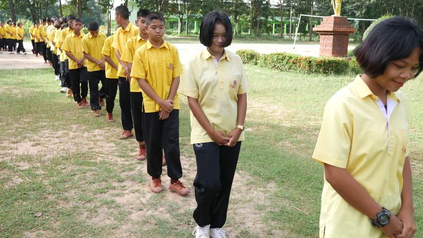 Buriram,Thailand - September 18 2018 : Students in school walking inline or walking meditation in to classroom. | Shutterstock HD Video #1016534878