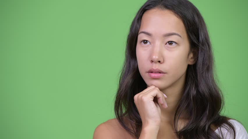 Young happy beautiful multi-ethnic woman thinking | Shutterstock HD Video #1016555488