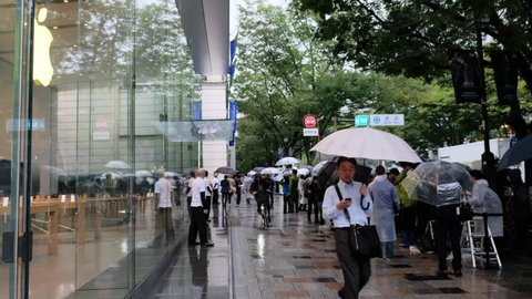 TOKYO, JAPAN - SEPTEMBER 21ST, 2018. Crowd of people at Omotesando sidewalk for the newly released Iphone XS, XS Max and Apple Watch Series 4 despite the rain.