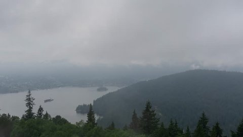 Timelapse of Deep Cove and Indian Arm during a cloudy summer day. Taken from the top of Burnaby Mountain, Vancouver, BC, Canada.